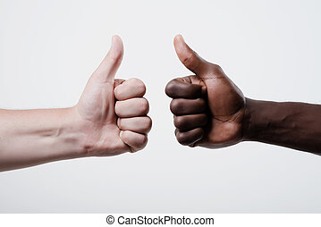 Thumbs up - African American man and caucasian man show...