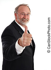 Thumbs up - Senior businessman giving the thumbs up.