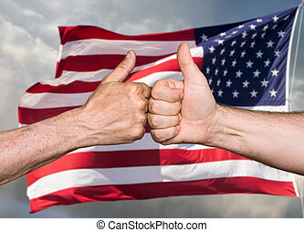 Thumbs up sign against of USA flag