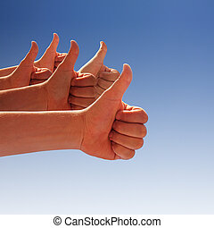 thumbs up - men's hands make thumbs up on blue sky