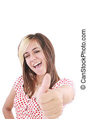 Thumbs Up! Studio partrait of young business woman showing OK sign, looking at camera and smiling. Isolated on white background