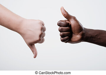 Thumbs up, thumbs down - African American man Thumbs up,...