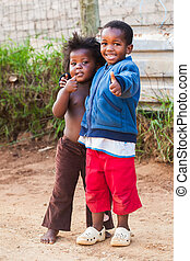 Thumbs Up - Two kids in the street showing a thumbs up to ...