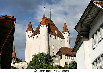 Old castle in Thun, next to Aare river. Switzerland town.