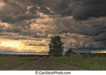 The warm summer day is turning into a thunder storm in the rural Finland. Heavy clouds are gathering over the fields.