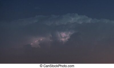 Thunderstorm clouds at night with lightning - Lightning...