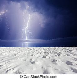 storm - Thunderstorm with lightning in winter meadow. Dark...