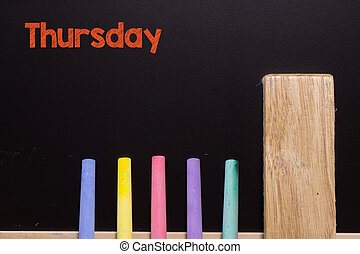 Thursday on Blackboard with chalk and eraser