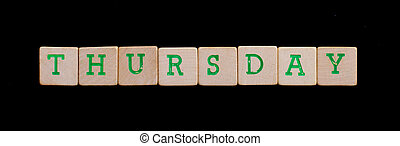 Thursday spelled out in old wooden blocks
