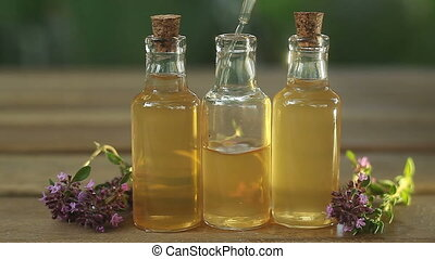 thyme essential oil in  beautiful bottle on table
