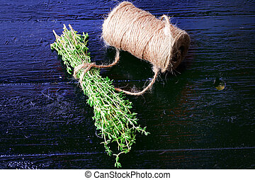 thyme on a black wooden background