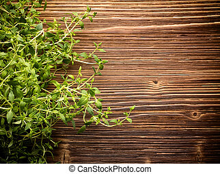 Thyme. - Thyme and wooden textured background.