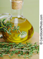 Thyme with Olive Oil - Fresh thyme sprig with olive oil in...