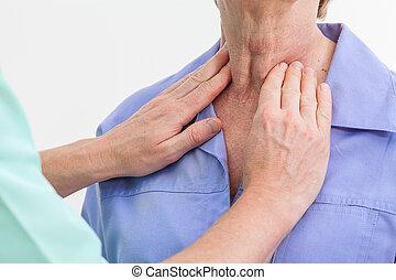 Thyroid problems - Problems with thyroid, nurse examining a...