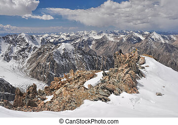 Breathtaking view of mountain peaks and glaciers in Tian Shan mountain range in Kyrgyzstan