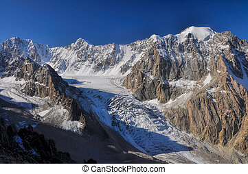 Majestic mountain peak and glacier in Tian Shan mountain range in Kyrgyzstan