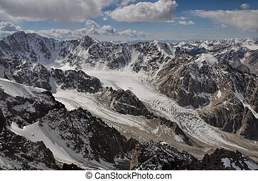 Majestic mountain peaks and glaciers in Tian Shan mountain range in Kyrgyzstan