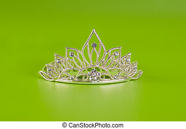 Tiara or diadem with reflection on green background