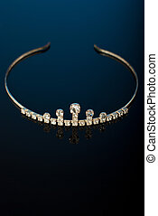 Tiara on black background with reflection and blue lights