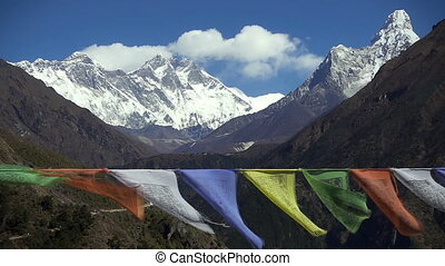 Tibetan buddhist prayer flags blowing in the wind. - Tibetan...