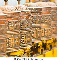 Tibetan Buddhist prayer wheels at Boudhanath stupa in Kathmandu, Nepal.