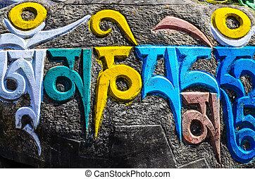 Tibetan buddhist religious symbols on stones