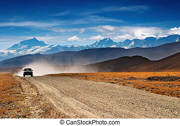 Tibetan highlands - Tibetan road and mount Everest on...