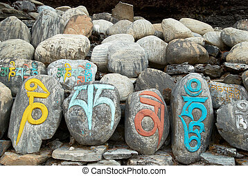 Tibetan prayer stones - Tibetan colorful prayer stones with...