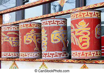 Tibetan rotatable design in a temple, closeup of photo