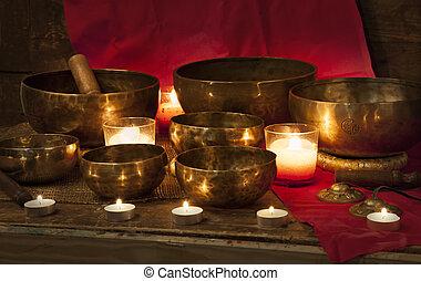 Tibetan singing bowls on red - Tibetan singing bowls with ...