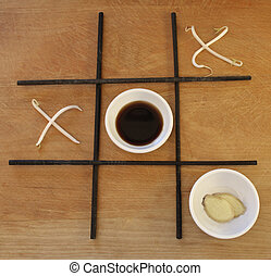 tic tac soy 1 - Bean sprouts are the x\'s and round white...
