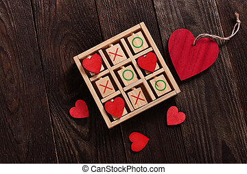 tic tac toe game with hearts and xo letters as love game...