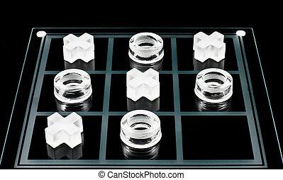 Tic-tac-toe - Glass tic-tac-toe game on black background