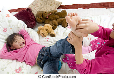 Tickling feet - Two sisters playing on the bed, tickling ...
