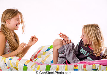 tickling girls - Two young children enjoying their colorful...