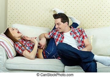 Tickling - Playful guy tickling his girlfriend