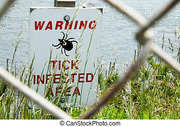 Ticks Infested Warning Sign - Warning Sign of Ticks in an...