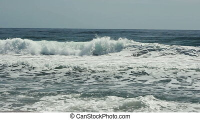 tidal bore at summer - sea waves with breakers at summer day
