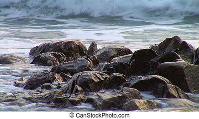 tidal bore - waves on the wild coast of the sea