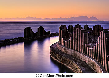 Gordons Bay tidal pool at sunset with Table Mountain as backdrop