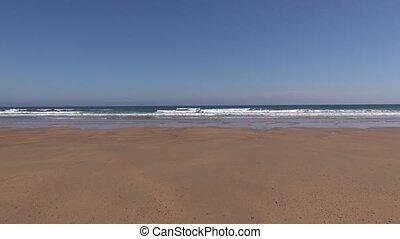 tide timelapse - ocean water tide moving fast on sand in...