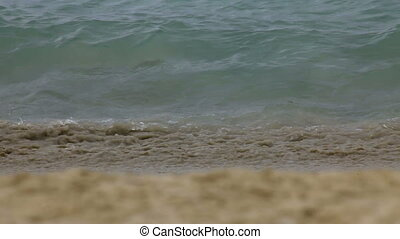Tide - Waves of the sea crushing against the sandy shore,...