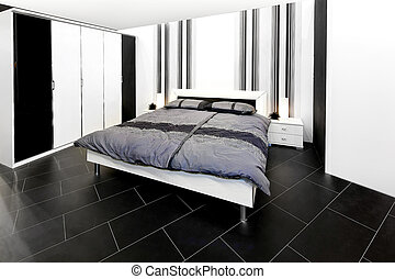 Modern bedroom with black and white wardrobe