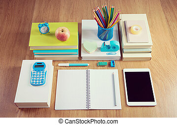 Perfectly tidy school student stationery on wooden surface.