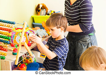 Tidy up own toys - The mom tidy up the toys and teaches the ...