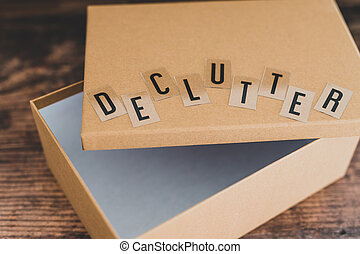 declutter message on top of semi-open empty box to fill with items to give away