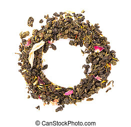 Tie Guan Yin tea with the petals of lilac, hibiscus and sunflowe, isolated on white background. Organic green tea. Top view. Close up.