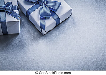Tied present boxes on blue background holidays concept