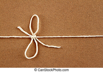 Tied string - Tied bow in string on brown parcel