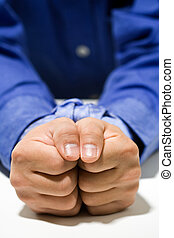 A conceptual shot of a businessman with his hands tied up